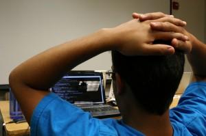 coder staring at laptop screen